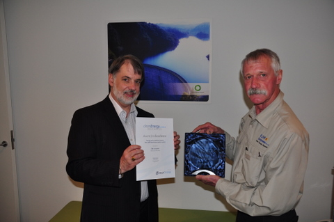 Rob McCauley accepting the Clean Energy Council award from Rob Jackson